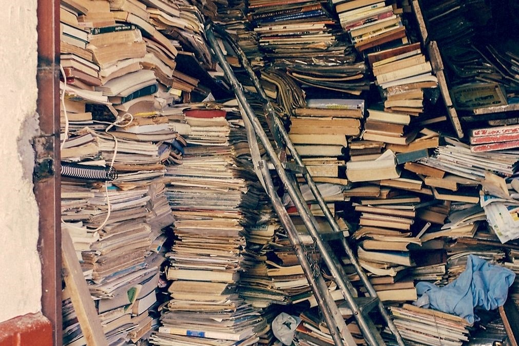 Piles of books in a garage